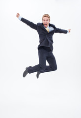 Enthusiastic businessman jumping mid-air