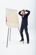 Screaming businessman standing at flipchart with abundance of post-its
