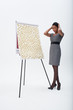 Confused businesswoman standing at flipchart with abundance of post-its