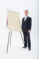 Businessman standing at flipchart with abundance of post-its