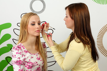 makeup artist applying mascara on the eyebrowse