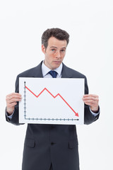 Businessman holding descending line chart