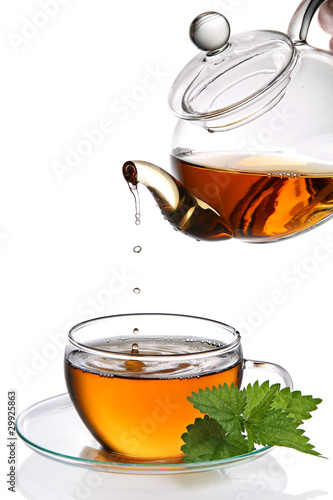 Tea dripping into cup (clipping path included)