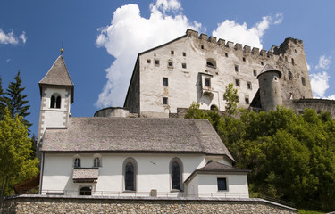 castle and church in Austrian Alps