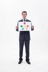 Smiling businessman holding molecule symbol