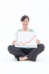 Smiling businesswoman holding ascending line chart