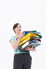 Businesswoman holding stack of file folders