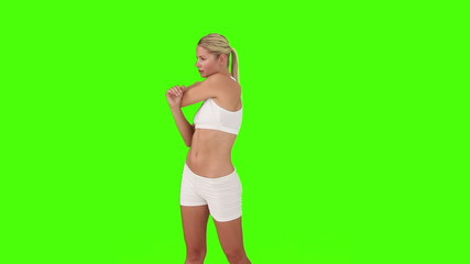 Blond woman in sportswear doing some excercises