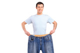 Portrait of a weight loss male showing his old jeans