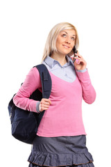 Female student with a school bag talking on a phone