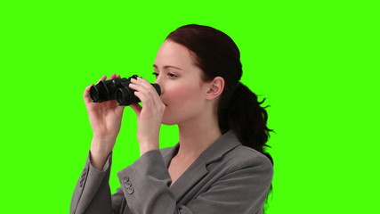 Woman looking at the landscape with a pair of binoculars