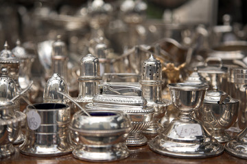 Silver ornamental objects on market table