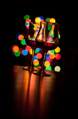 two wineglasses  and abstract lights background