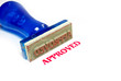 approved blue rubber stamp