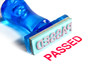 passed blue rubber stamp