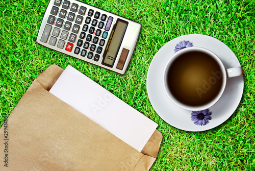White cup of coffee and brown envelope