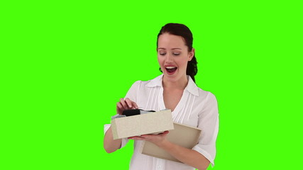 Dark-haired woman opening a present