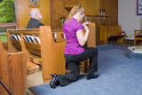 Caucasian Woman Kneeling Crossing Herself Church poster