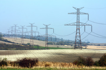 high voltage transmission towers in line