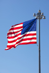 United States Flag in front of clear blue sky