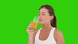 Cute brunette woman drinking orange juice