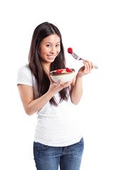 Asian woman eating fruit