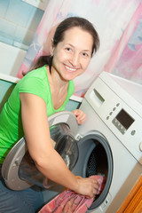 Mature woman with washing machine
