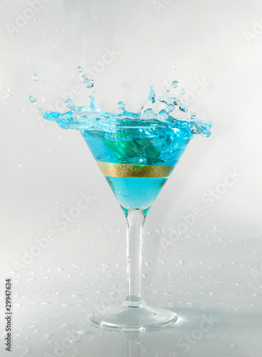 splashing on blue martini on white stock photo