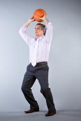 Senior man throwing a basketball ball
