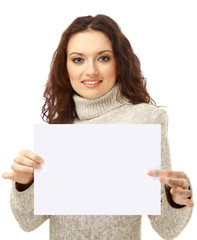 Young woman holding an empty billboard over white