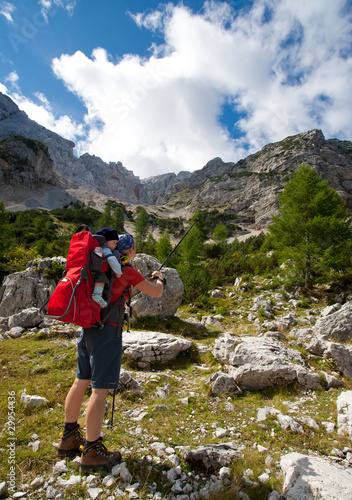 hiking in alps, mother and son in baby carrier