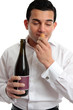 Man sniffing wine cork