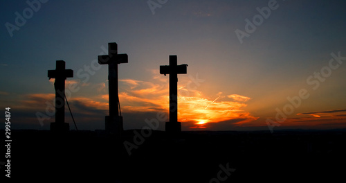 Three crosses on sunset.