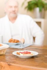 Senior mature man - breakfast at home