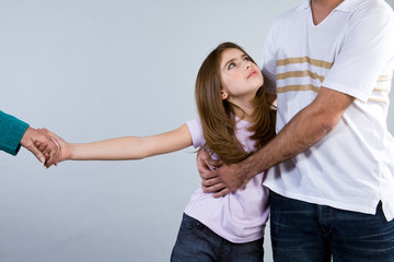 Girl holding her father