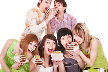Group of happy young people with cake.