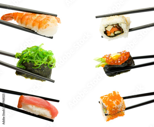 Sushi with chopsticks isolated over white background - 29968025