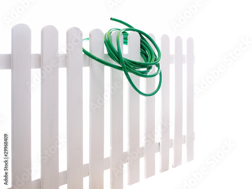 water hose on the wooden fence