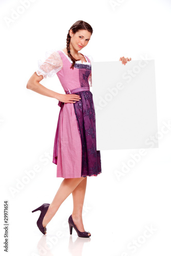 Young girl with dirndl dress holding billboard