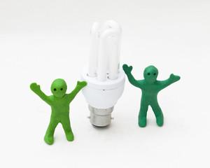 green men with energy saving bulb
