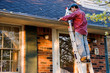 Man Cleaning Gutters - 29977022