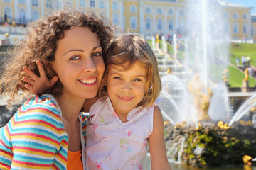 Daughter with mother  near fountains of Petergof
