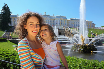 Mother with daughter  near fountains of Petergof