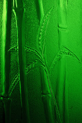 green embossed bamboo leaves and stems on stained glass