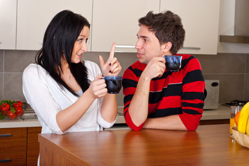 Young couple drink coffee and talking