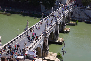 Many tourists on Sant' Angelo Bridge at summer day in Rome
