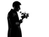 silhouette  man offering flowers