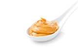 Creamy peanut butter in a white spoon