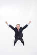 Enthusiastic businessman raising his arms