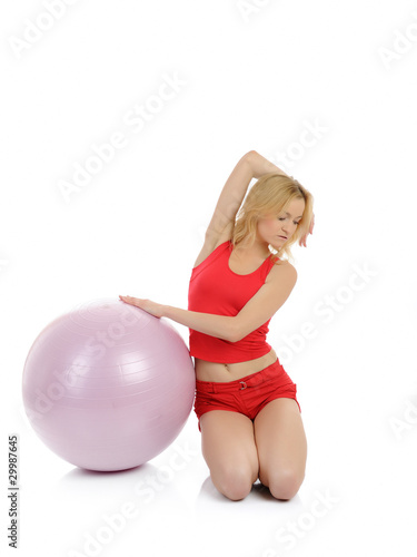 Beautiful fitness woman doing exercise with pilates ball. isolat